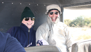 Photo by Stephen Powell Wildlife Artist Photographer. Stephen & Colleen keeping out of the wind on the Caprivi Strip
