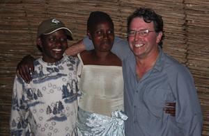 Photo by Stephen Powell Wildlife Artist Photographer Betty Her Husband and Stephen (Me) Rwanda village stay.